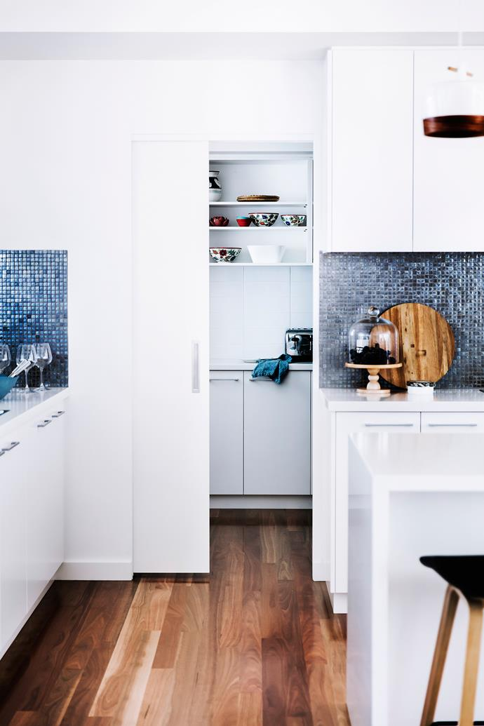 A butler's pantry expands the kitchen's functionality.