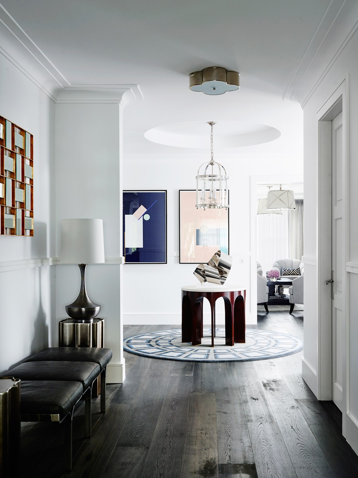 The entrance of a home designed by Greg Natale which has an art gallery feel, with art deco inspired metal artworks and furniture on display. *Photo: Anson Smart*