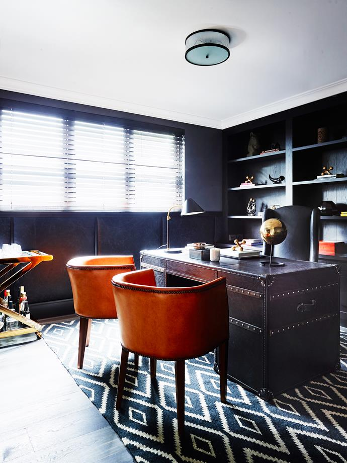 Leather panelled walls and dark timber joinery evoke a masculine mood.
