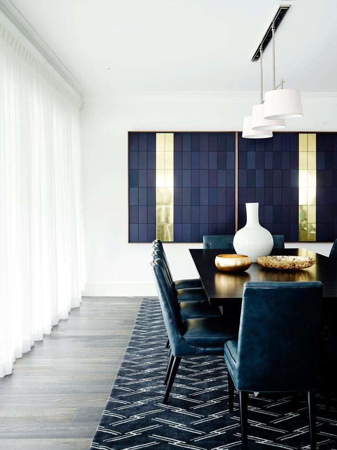 Hints of blue are carried through in the furniture, finishes, objects and art.