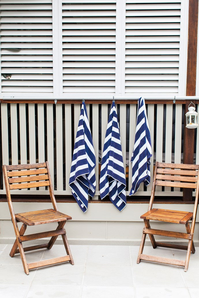 """""""We found the white shutters on the deck at a recycling yard for only $120. Bruce had to modify them, cut them down to fit and paint them. But they look new!"""""""