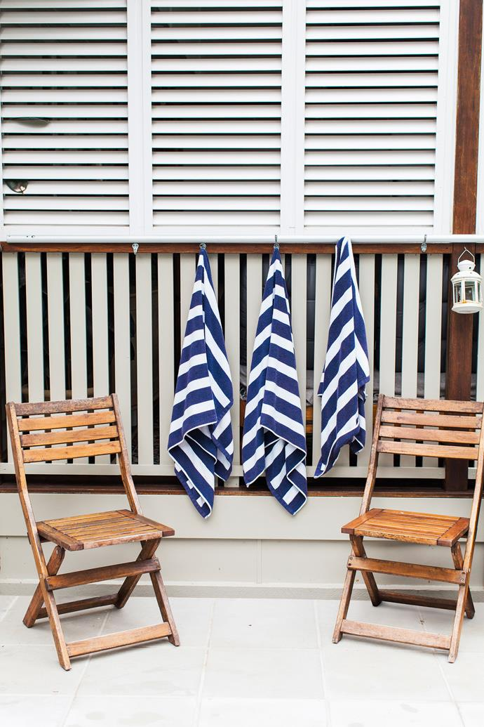 """We found the white shutters on the deck at a recycling yard for only $120. Bruce had to modify them, cut them down to fit and paint them. But they look new!"""