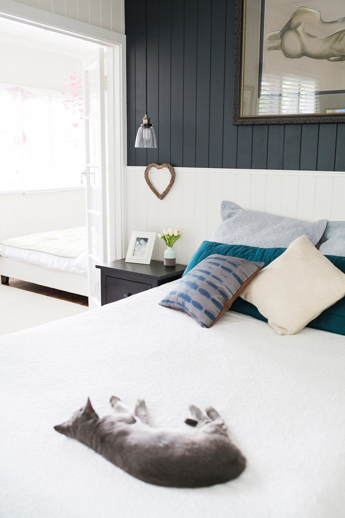 The two-tone paint combination in the main bedroom adds sophistication and has Grayce, the rescue cat's, tick of approval!