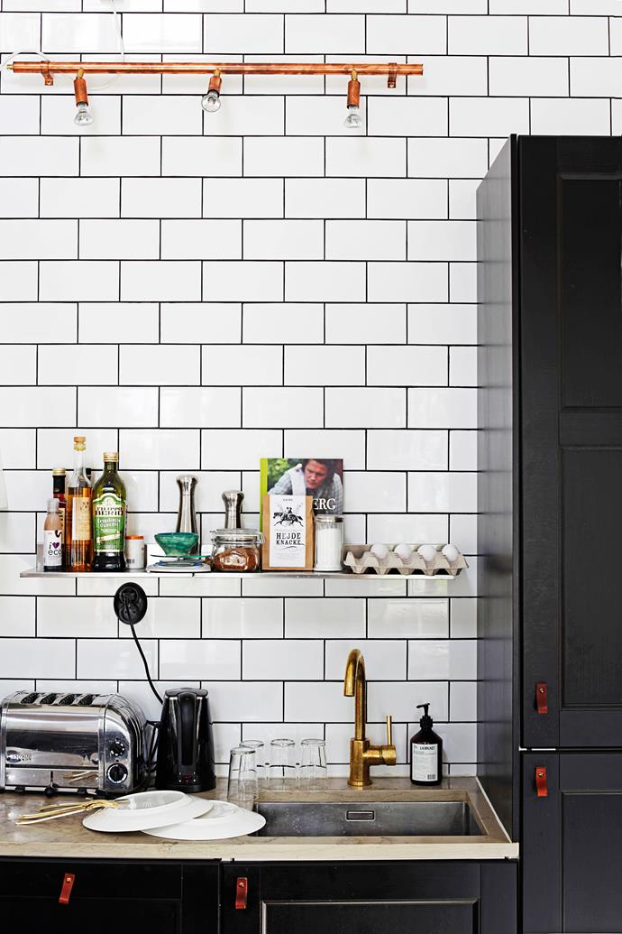 Affordable leather handles were custom-made for the kitchen cupboards and doors. Worktops are made from limestone, the tap, brass.
