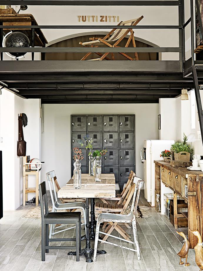 Instead of a traditional dining setting, in this eat-in kitchen a mix of chairs surround a trio of small square tables. The look works because they all share a similar aged patina.