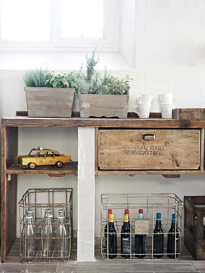 Pottery planters, old wooden crates and wire baskets can act as clever kitchen storage ideas.