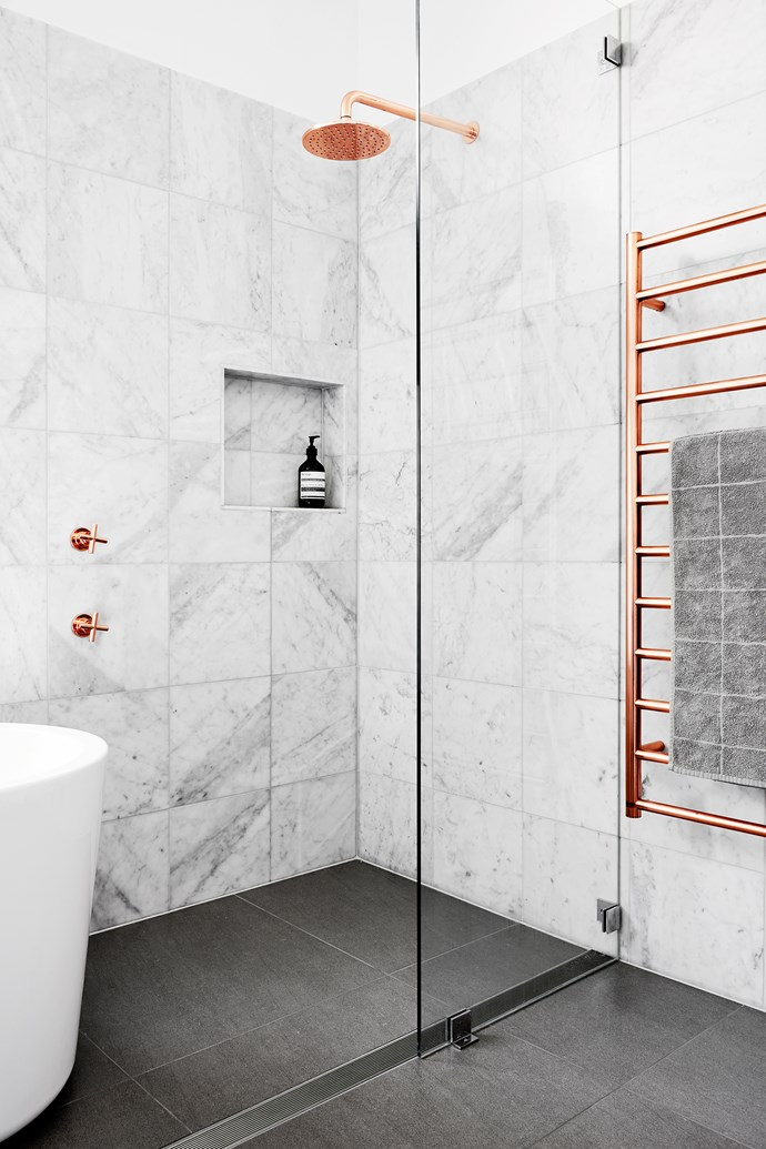 """A crisply tiled recess addresses the need for in-shower storage. Brodware City Plus shower and arm in Copper Organic finish, $665, [Eagles Plumbing Plus](http://www.eaglesplumbing.com.au/