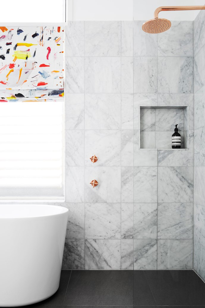 """""""I pushed the homeowners to be brave and make a statement with bold fabric for the blind,"""" says Stewart. Carrara marble tiles (300x300mm), $297/m2, [Earp Bros](https://earp.com.au/