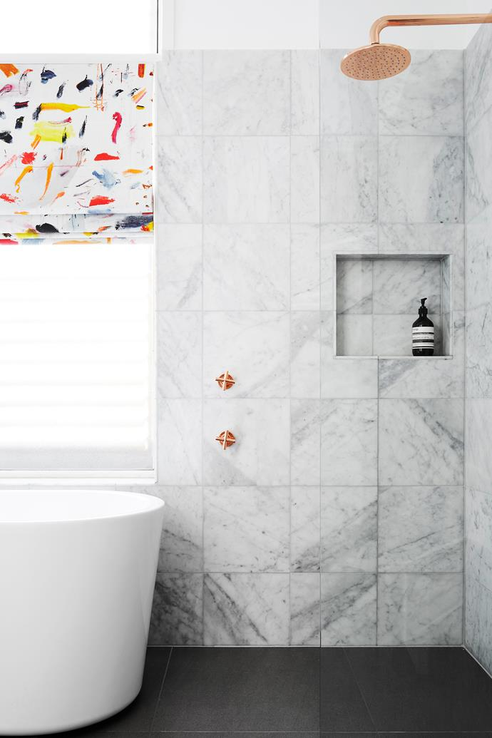 """I pushed the homeowners to be brave and make a statement with bold fabric for the blind,"" says Stewart. Carrara marble tiles (300x300mm), $297/m2, [Earp Bros](https://earp.com.au/