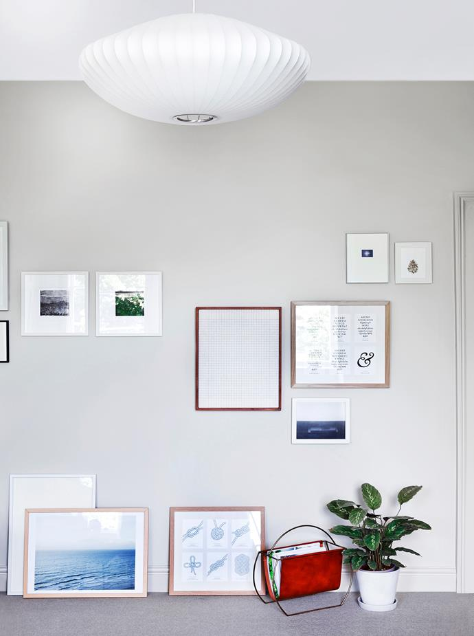 Not all of Rosa's artworks adorn the wall; she's purposefully displayed some on the floor – a great idea for renters!