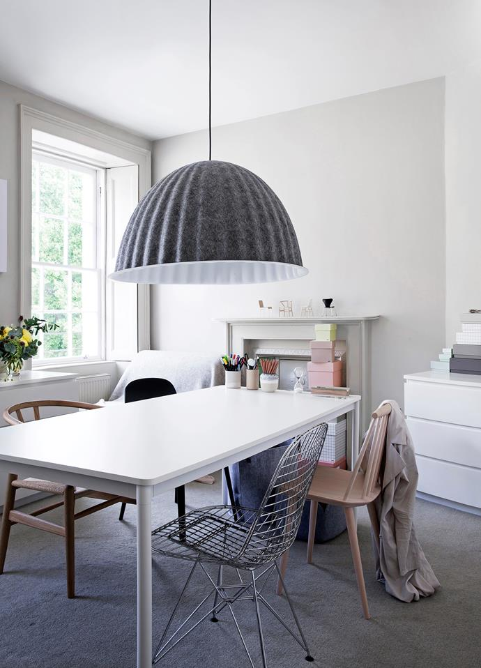 "Rosa's work space is dominated by a grey Muuto ""Under The Bell"" pendant light, which makes the space more design oriented."
