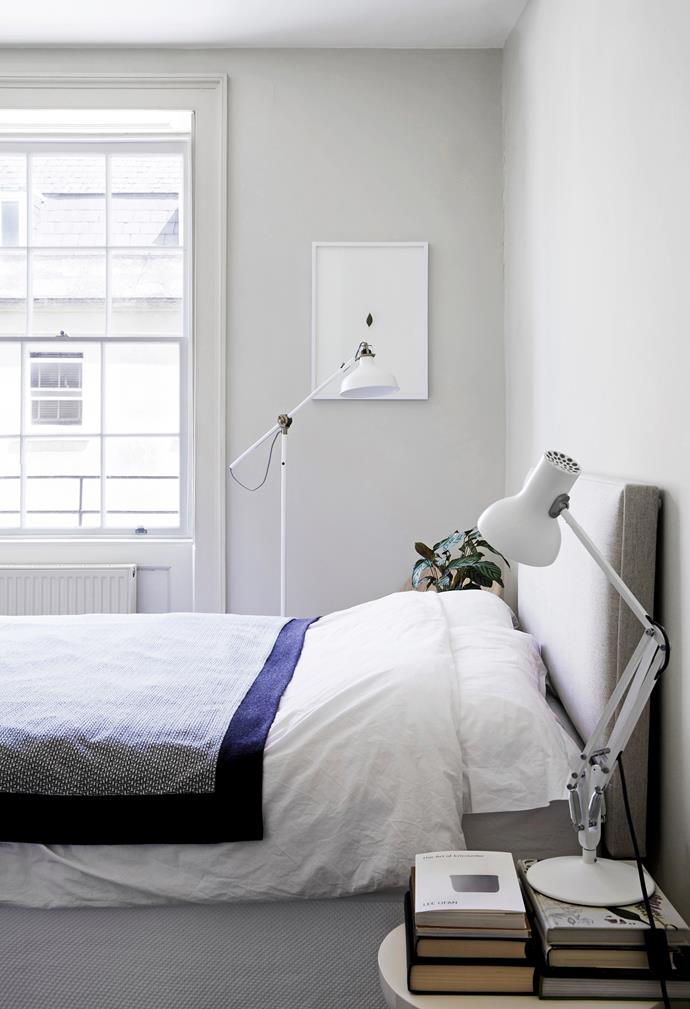 The bedroom is yet another white space, except for the bedspread, which adds a touch of inky charcoal. Instead of a matching pair of table lamps, Rosa has chosen a floorlamp from Ikea and a simple desk lamp.