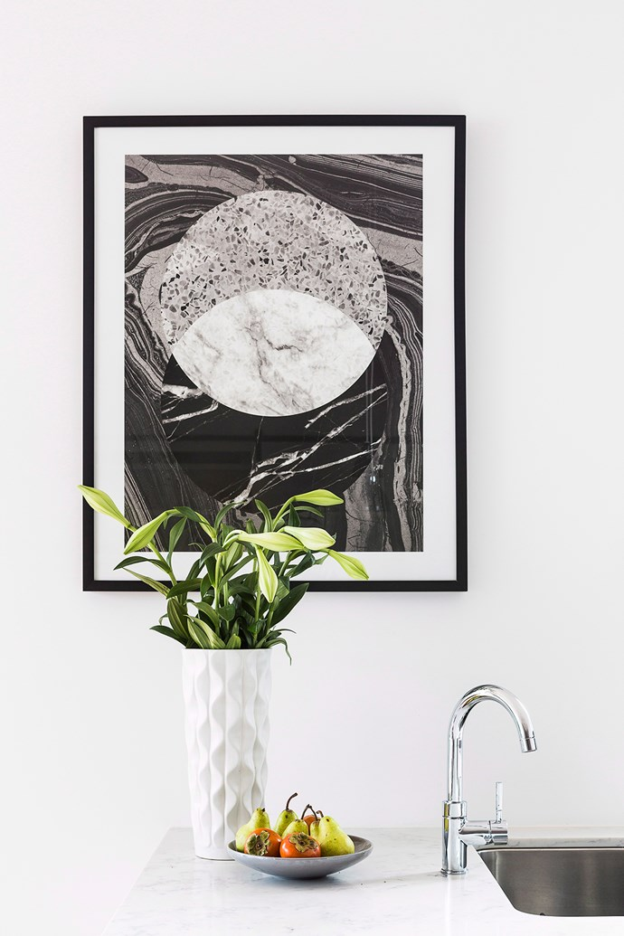 Use statement artwork and fresh greenery to add a splash of colour and depth to a neutral space. *Photo: Maree Homer / bauersyndication.com.au*