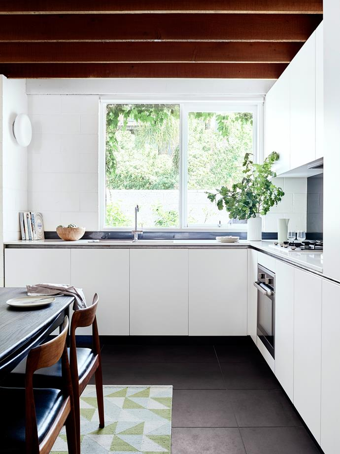 """Jamie and Jo's solution was to remove the partition to create a more generous open-plan kitchen/dining space. A new L-shaped kitchen was installed to optimise  floor space. Joinery by [Woodman Cabinets & Joinery](http://www.woodmancj.com.au/