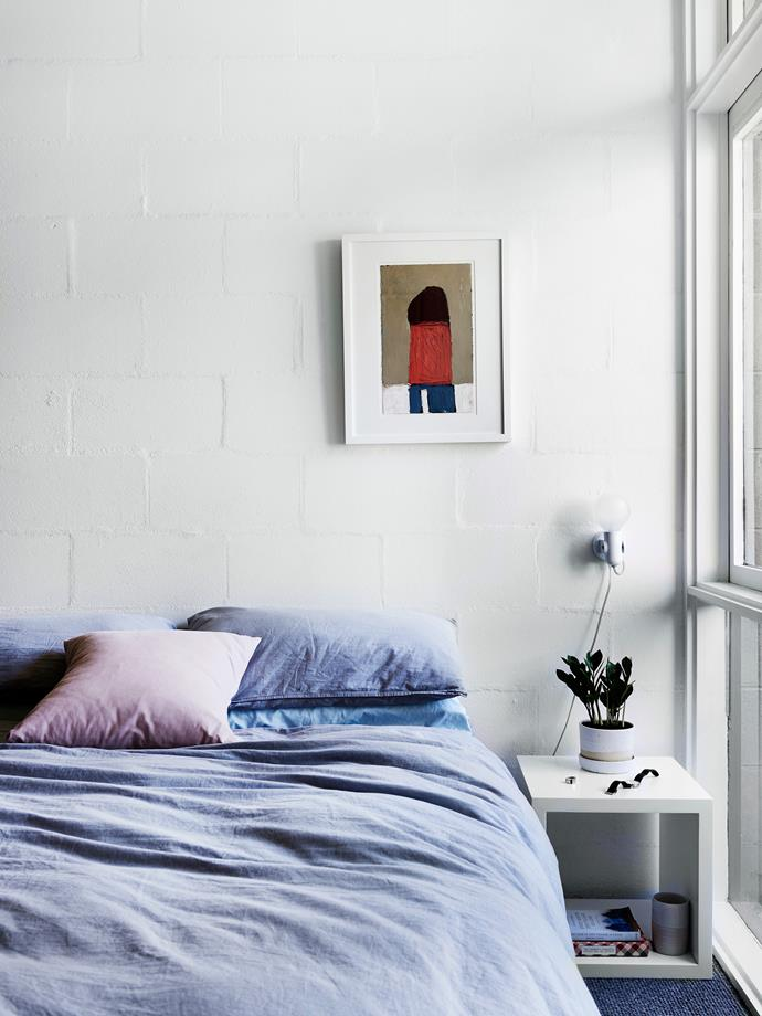 Painting the house white throughout brightened the interior, which feels more spacious. Bedlinen from [I Love Linen](http://www.ilovelinen.com.au/). Painting by Ruth Howard.