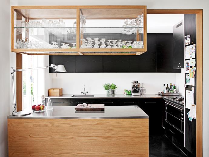 The above-bench storage is made from glass framed in oak. It is open on the side facing the kitchen, providing easy access to oft-used glassware, just like in a bar.