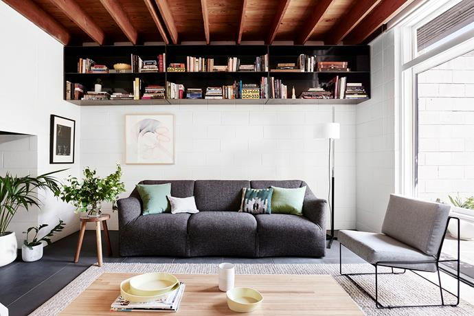 Given the size of the home, a mere 80m2, maximising storage was essential. In the living room, thin-profile steel shelves were mounted at ceiling height to retain useable space at ground level. The original Cassina Tentazione sofa previously belonged to Jamie's mother, who received it as a wedding gift.