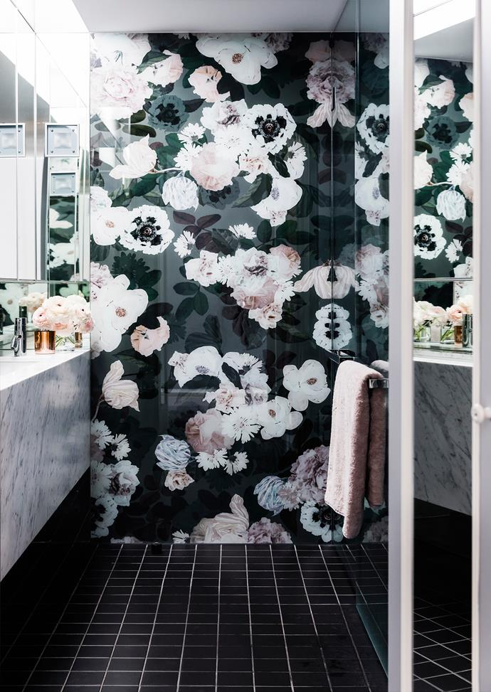 Inspired by an [Ellie Cashman](https://www.elliecashmandesign.com/) wallpaper, Sean had a large floral design printed onto glass for a glamorous wall treatment.