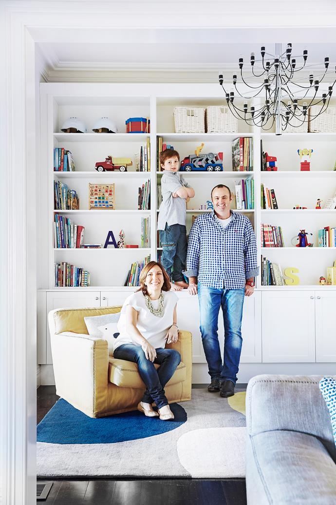 "Little Hugo with his mum and dad, Anna Maria and Chris Stillone, in the [Hamptons inspired](https://www.homestolove.com.au/a-hamptons-inspired-holiday-home-south-of-perth-5122|target=""_blank"") library."