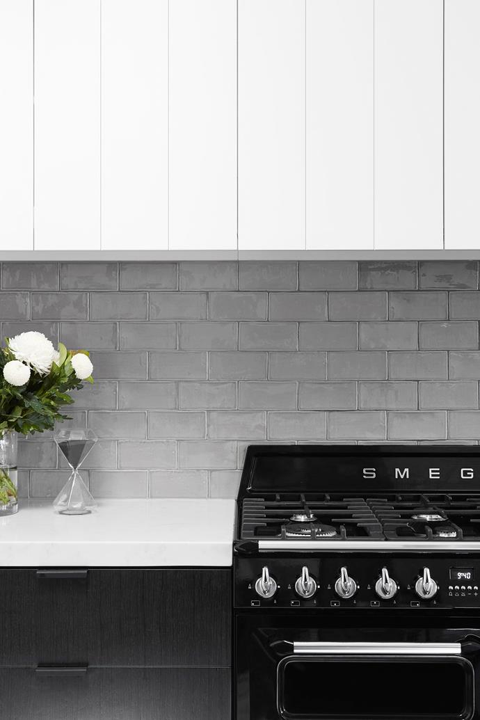 The colour of the tiles was chosen to echo the shade of grey veining in the Smartstone benchtop.