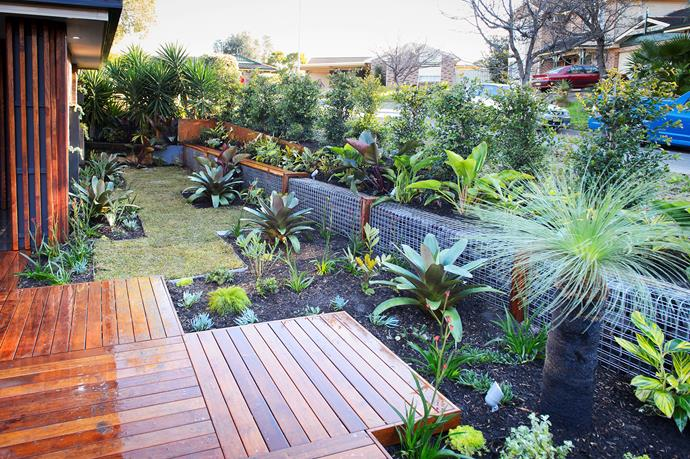 AFTER: For a cohesive look, the deck, cladding and wall accents are of the same timber style.
