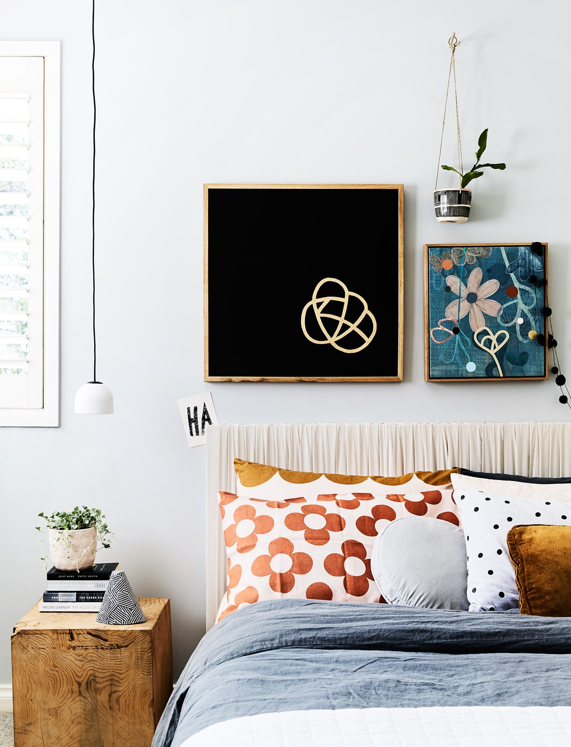 "The gorgeous bedhead was created by [homeowner, designer and artist Rachel Castle](https://www.homestolove.com.au/rachel-castles-colourful-and-quirky-sydney-home-4729|target=""_blank"") by covering some canvas in silk. *Photo:* Sharyn Cairns"