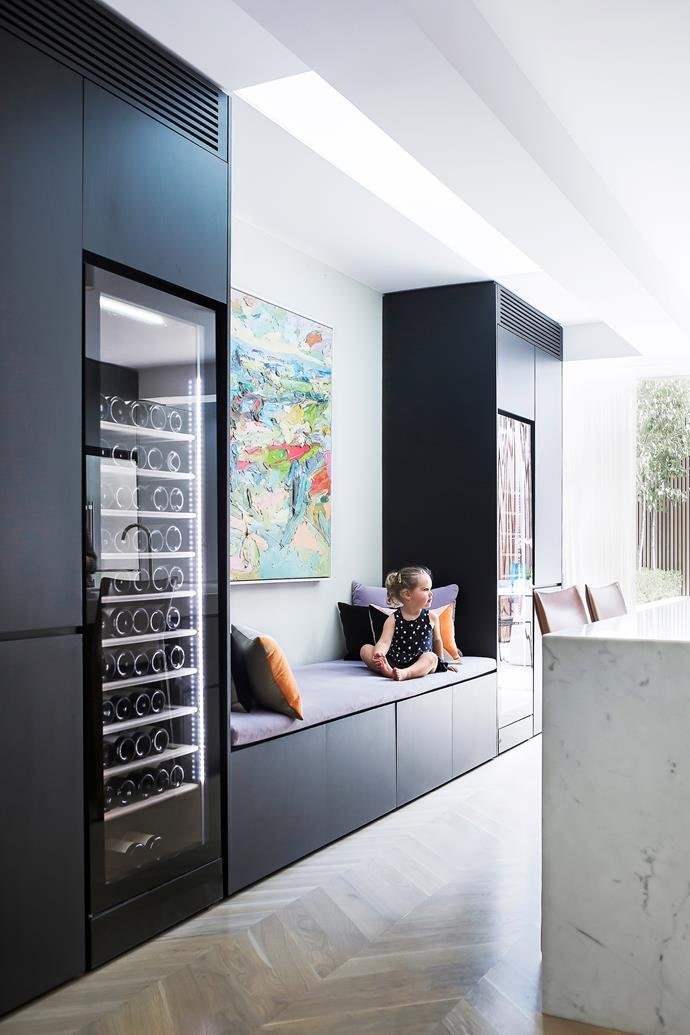 The Vintec wine fridges are lit from within, adding another element of sophistication to the slick kitchen at night.