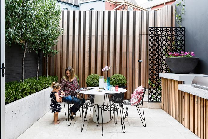 Owner Katie and her daughter Grace share a moment in the light-drenched courtyard. Landscape design by [Melissa Wilson](http://melissawilson.com.au/), construction by Matthew Wood of [Earth Stone Wood](http://earthstonewood.com.au/).