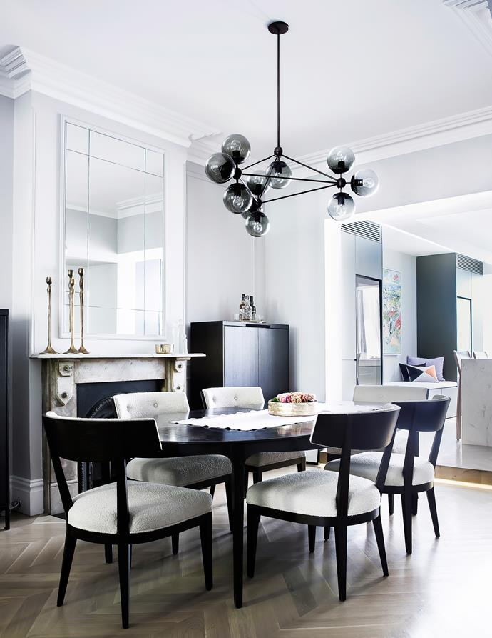 """Across all levels, elegant and timeless decor unites rooms and eras. """"We were after a classic Parisian feel,"""" says Katie."""