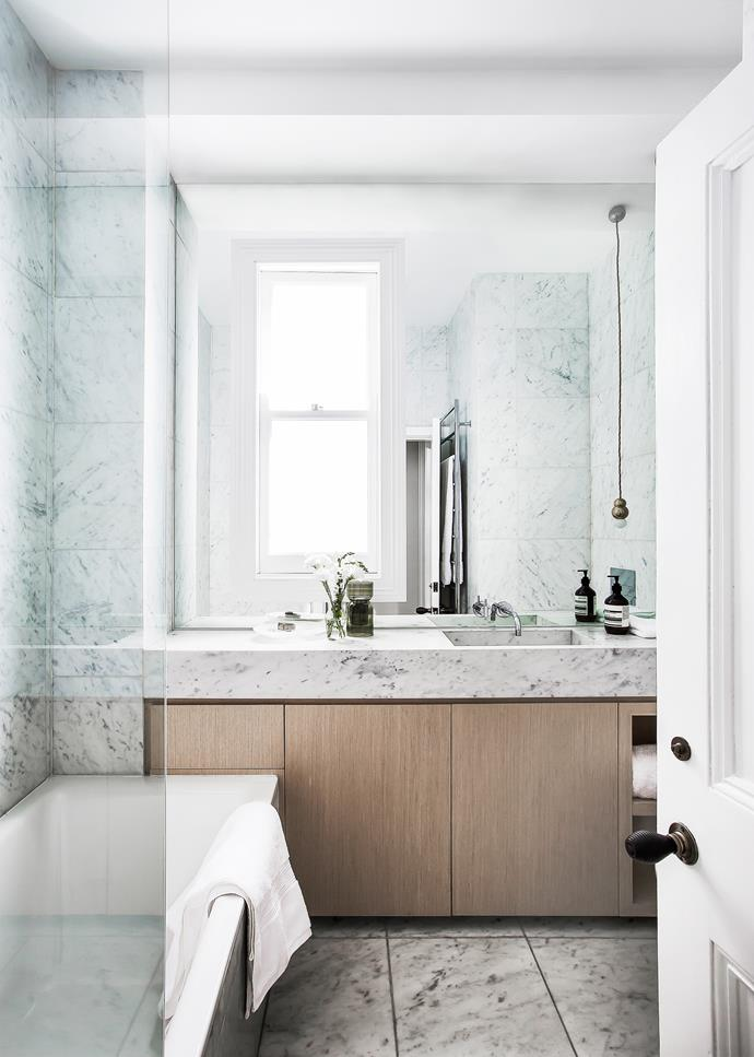 Floor-to-ceiling Carrara marble, including a custom-made basin, feels wonderfully luxurious.