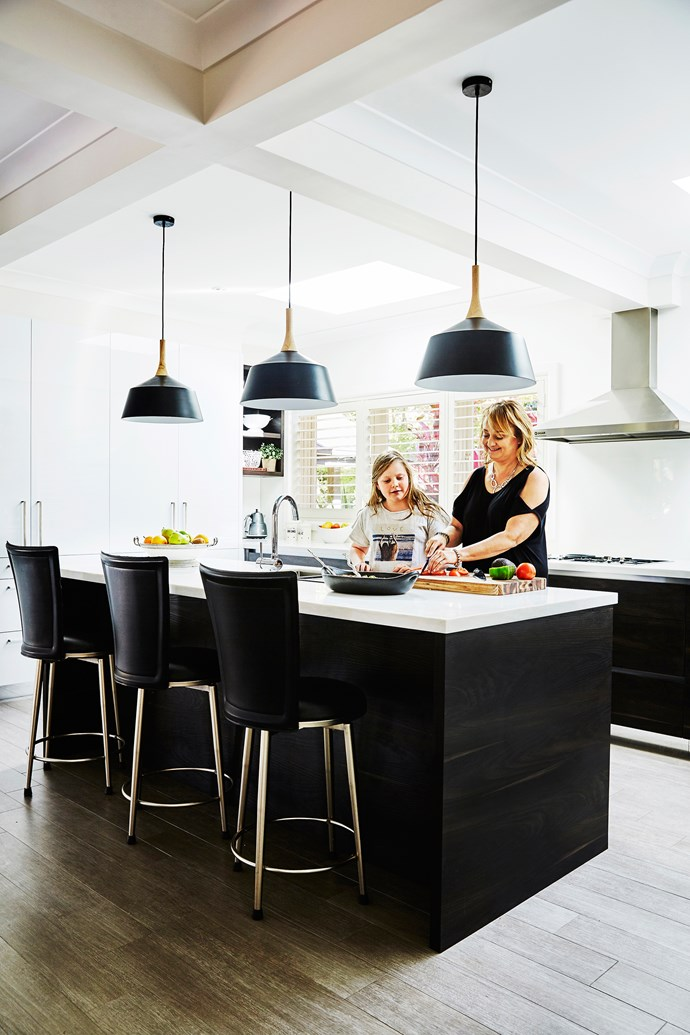 """""""By knocking down a wall between the kitchen and the formal dining room we created an enormous space for an open-plan kitchen, which provides for practical entertaining because everyone wants to gather around the cook!"""" says Nicole."""