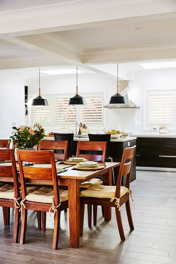 Practical, timber-look porcelain floor tiles flow from indoors to the outdoor room.