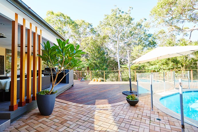 Backing onto a national park, the home and pool are like a private resort.