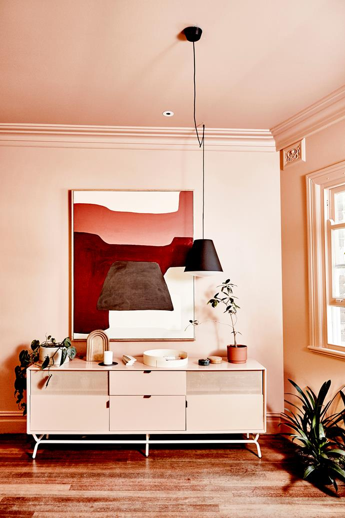 """The studio walls, ceiling, architraves and door frames are all painted in the one colour: an earthy terracotta hue called Baroque by [Resene](http://www.resene.com.au/