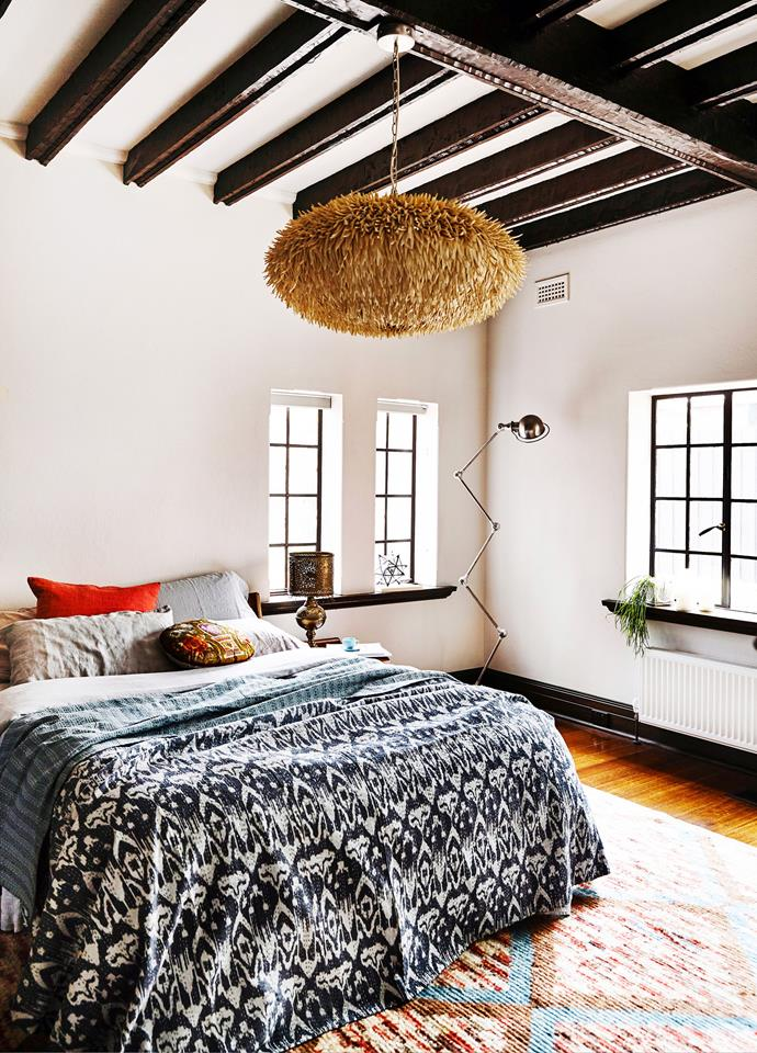 Tribal rugs and throws and textured lights create softness in bedrooms.