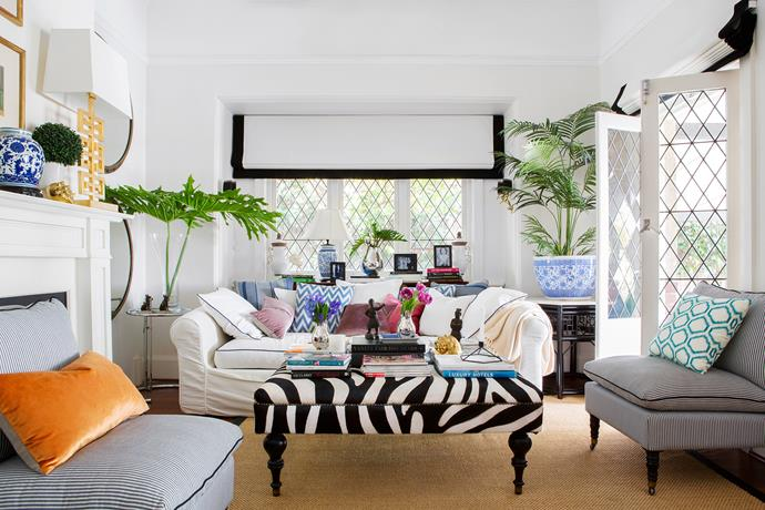 Eye-catching patterns have been skilfully blended to create a satisfying whole in the glamorous living room. Side table and striped armchair, from Sebastian Alexander. Designer buy: David Ross Archipelago ottoman, by Twiggy.