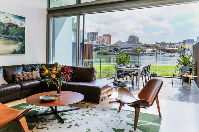 """""""When I met Karen and John, they felt they'd been 'camping out',"""" says interior designer Lisa Dinham. """"The design brief was to select new furniture and fixtures to suit the architecture [by SJB] and the outlook."""""""