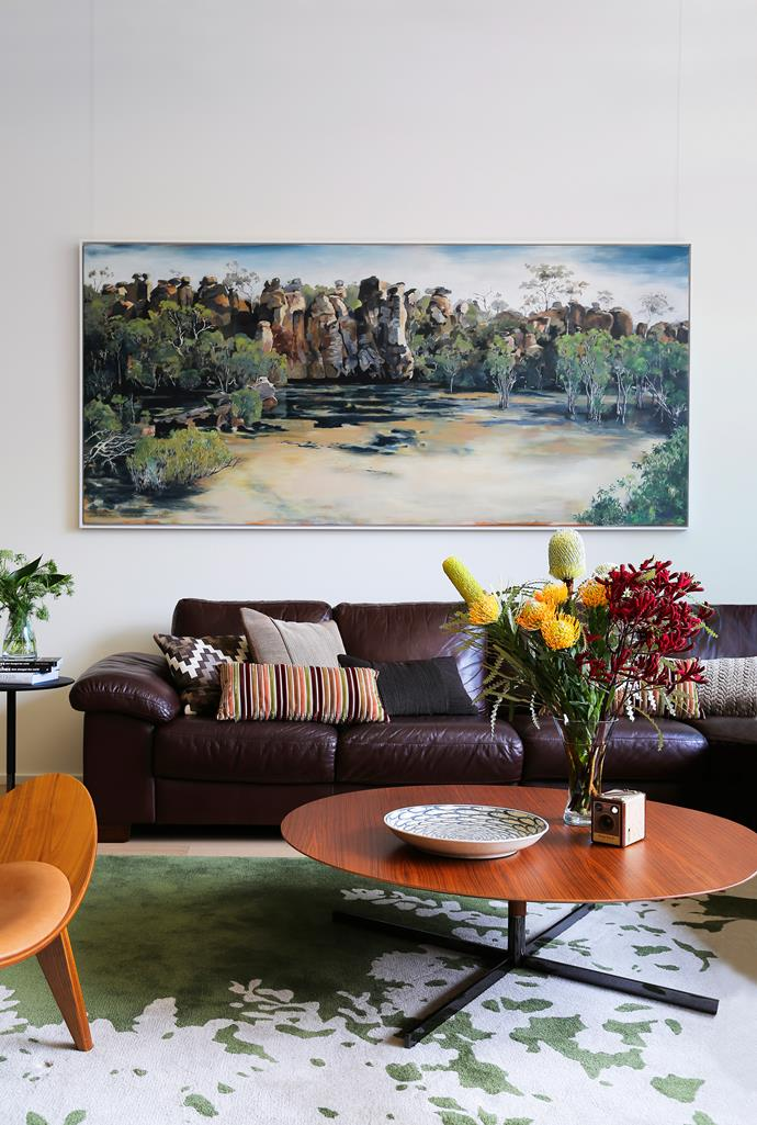 Karen and John asked [artist Angela Hayson](http://angelahayson.com/) to create a huge artwork for the living room and now *Guardians of the Waterhole NT*, seen here, is a defining feature of this room.