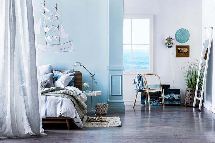 Layers of soft, lightweight fabrics in a palette of sea blues and cool neutrals make decorating a summery bedroom a breeze. *Styling: Kayla Gex | Photography: Maree Homer*