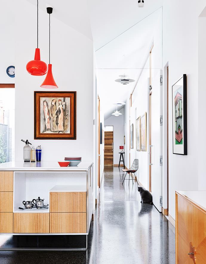 Polished-concrete flooring positively glows in the art-lined hallway.