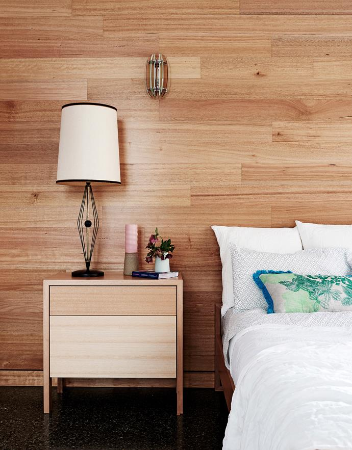 Timber has been employed as a naturally beautiful element throughout the home, including in the main bedroom's Tasmanian-oak feature wall.