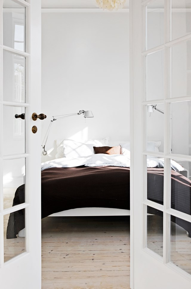 """This may look like a boutique European hotel but it's actually a [quaint family home in the countryside](https://www.homestolove.com.au/an-all-white-home-with-colourful-accents-4789 