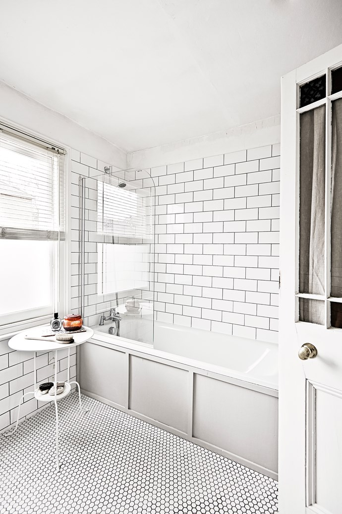 Venetian blinds allow for optimum light while providing privacy in the bathroom. The wall and floor tiles are new additions. The panelling is a clever trick to disguise an old (or ugly) bath.