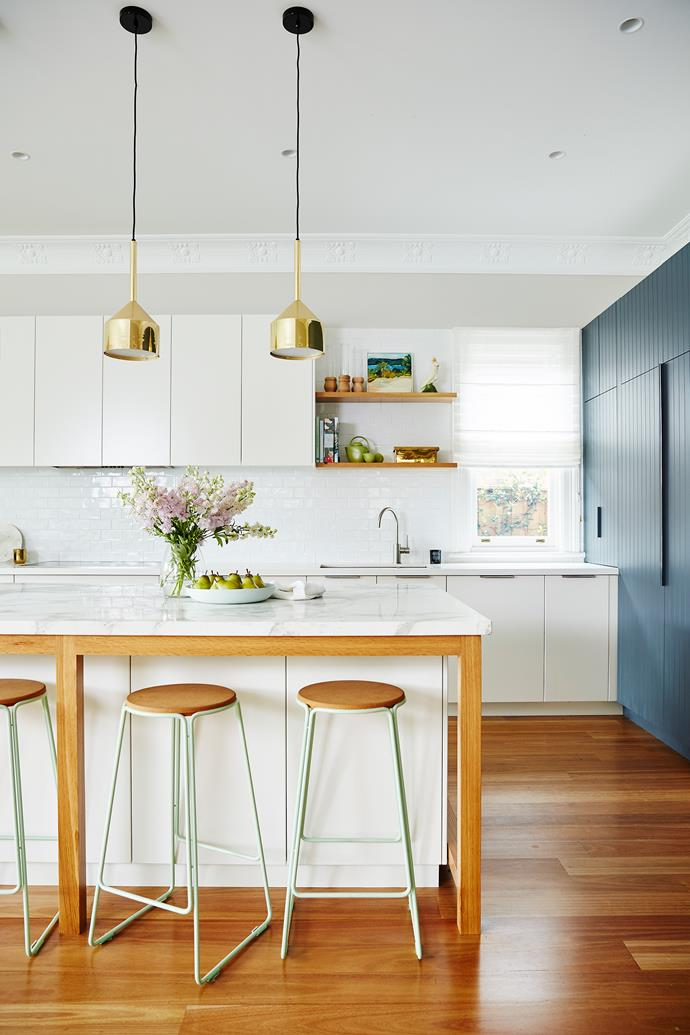 Modern, spacious, oodles of storage... the revamped kitchen has everything a family could want. Stools from [Great Dane](https://greatdanefurniture.com/). Pendant lights from [Mondo Luce](http://www.mondoluce.com/).
