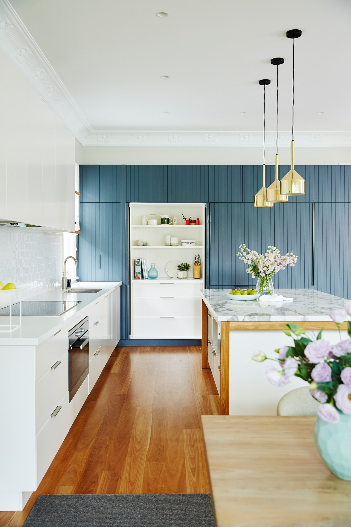 "Using marble sparingly in a kitchen, like the island bench in this [renovated Federation home](https://www.homestolove.com.au/federation-home-brought-to-life-with-colour-4800|target=""_blank"") is not only cost effective, but practical. [Cleaning and protecting marble](https://www.homestolove.com.au/how-to-clean-marble-benchtops-3745