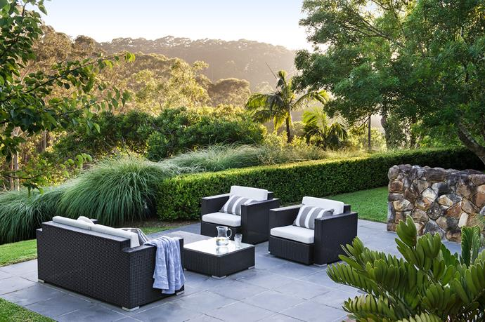 Concrete pavers set into the emerald-green lawn demarcate the entertaining area, which has views over Katandra Reserve. The *Buxus microphylla* 'Japonica' hedge is softened by draping *Miscanthus sinensis* 'Hiawatha'.