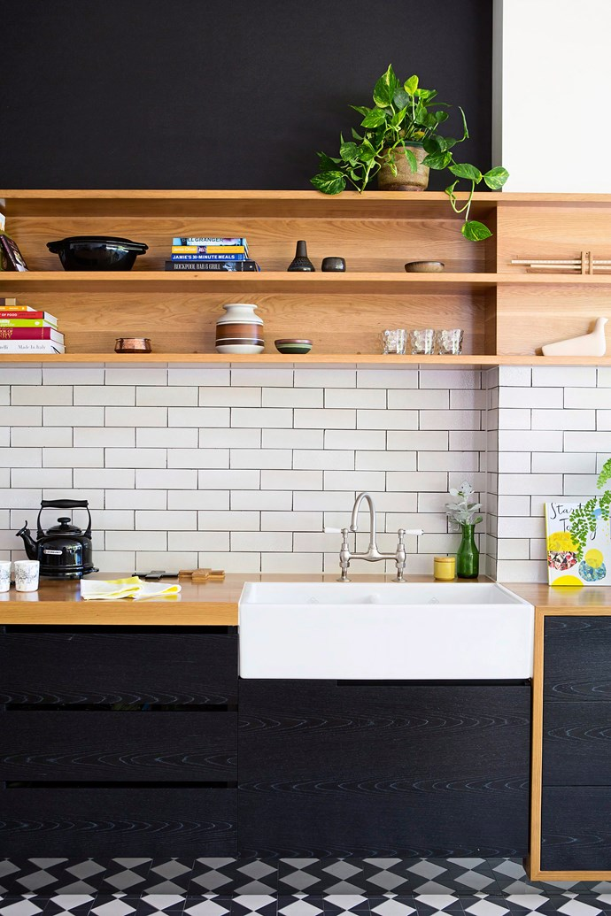 Soften the look with stainless steel, timber and a band of white tiles. Photo: James Knowler / bauersyndication.com.au