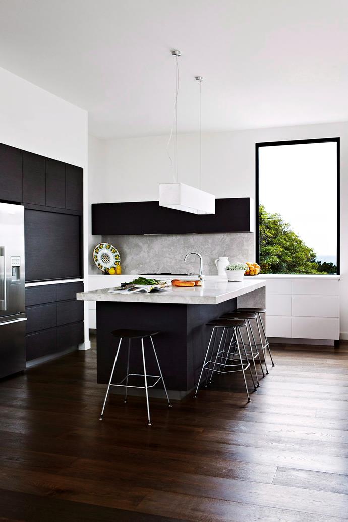 A contrasting benchtop and light put the focus on the workspace. Photo: bauersyndication.com.au