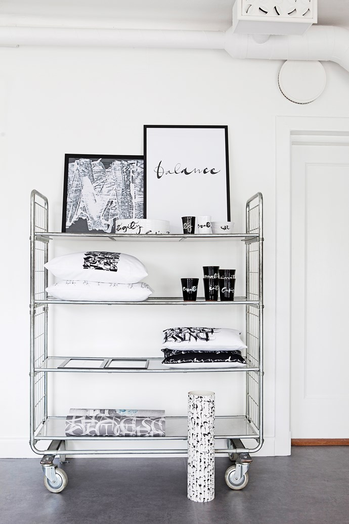 A shelf trolley is perfect for displaying Ylva's products including her prints, ceramics, cushions and wallpaper; they all feature her signature calligraphy.