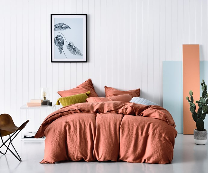 Although perfect for Autumn, when combined with fresh white and pastel blue, layers of terracotta linen add a summertime glow to this contemporary bedroom. Home Republic Vintage Washed Linen in Terracotta, $299.95 from Adairs. Photo: Adairs